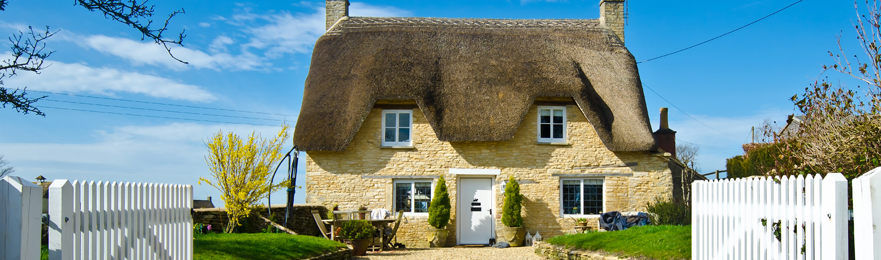 Household Insurance: A charming yellow cottage located in the countryside